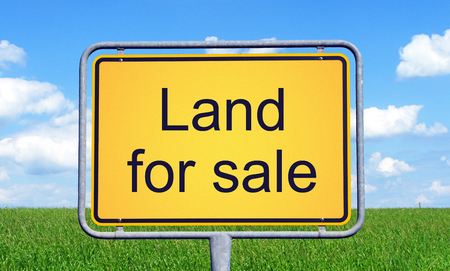 Land for Sale - yellow sign with landscape