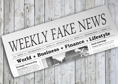 disinformation: Weekly News Fake Newspaper on wooden background