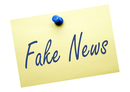 disinformation: Fake News - yellow note paper on white background