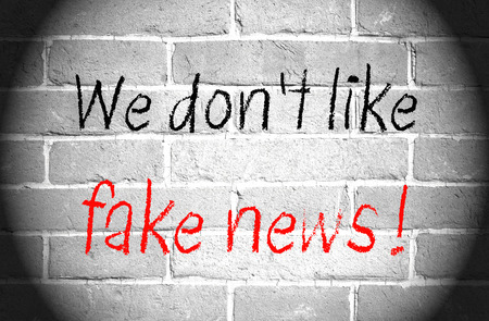 hoax: We do not like fake news - brick wall with text
