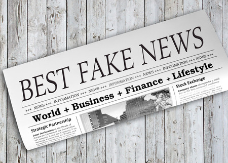 disinformation: Best Fake News Newspaper on wooden background Stock Photo