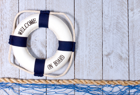 wood texture: Welcome on Board - lifebuoy with text