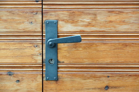 aged: Old wooden door and door handle with lock