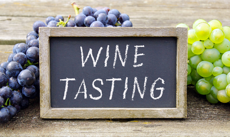 Wine Tasting - chalkboard with wine grapes Stock Photo