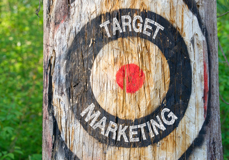 Target Marketing - target on tree with text in the forest