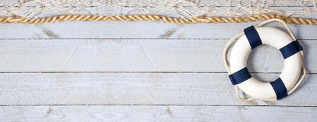Lifebuoy on empty horizontal wooden background