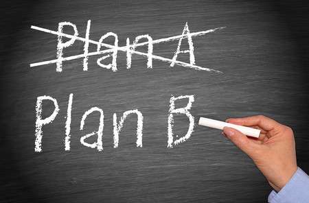Crossing out Plan A and writing Plan B on chalkboard