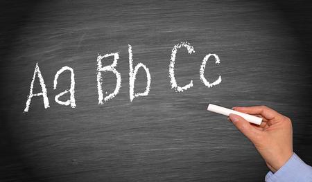 Writing ABC on chalkboard or blackboard