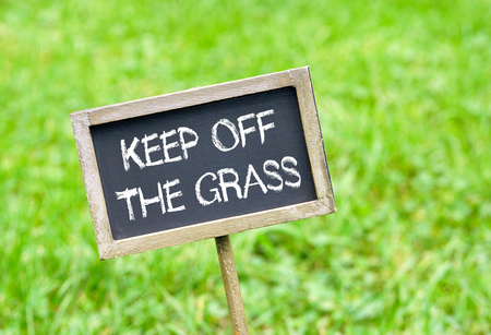 Keep off the grass - chalkboard on grass background