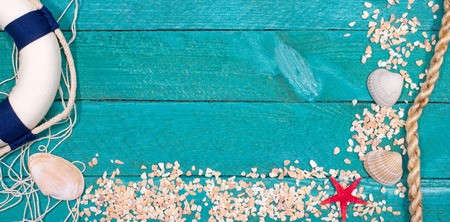 Beach utensils on wooden background - summer holidays Stock Photo