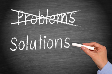 Crossing out problems and writing solutions on chalkboard or blackboard