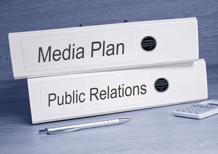 Media Plan and Public Relations - two binders in the office