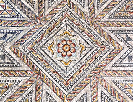 Ancient roman stone mosaic floor with geometric design