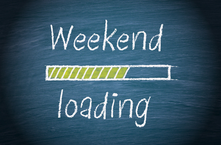 Weekend loading, blue chalkboard with text Stock Photo
