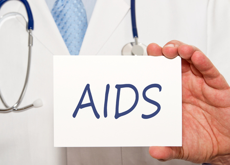 Doctor holding AIDS sign with text Stock Photo