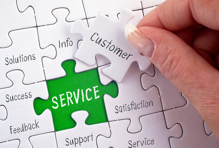 Service - business concept puzzle with female hand and text
