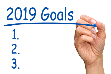 2019 Goals and Checklist - female hand with blue pen on white background Stock fotó