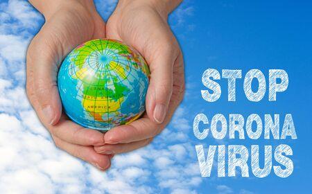 Female hands with globe, stop corona virus