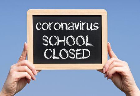 Corona virus, school closed, text on chalkboard Stock fotó