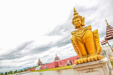 Thai golden sculpture near river