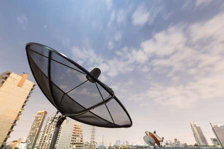 Black Satellite dish and moving sky