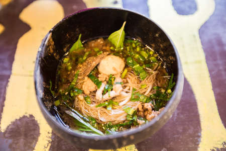 Thai noodle in coconut shell