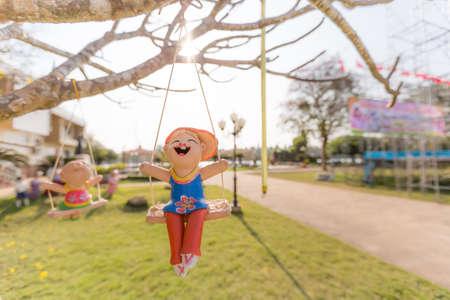 Happy kid sculpture enjoy swing
