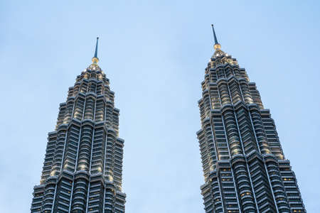 KUALA LUMPUR,MALAYSIA - JUNE 14, 2013: Twin peaks of the petronas towers in Kuala Lumpur, Malaysia.Malaysia is a member of Asean Economic Community AEC