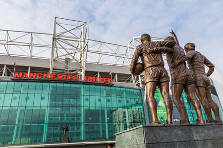 Manchester, England - February 27, 2016: The east stand of Old Trafford football stadium, home of Manchester United. With a capacity of 76,000 spectators, Old Trafford is the second largest stadium of any English football ground.