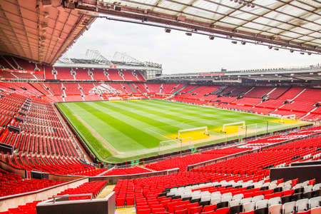 stadia: Manchester, UK - February 27, 2016: Old Trafford is a football stadium in Old Trafford, Greater Manchester, England, and the home of Manchester United. With a capacity of 75,635, it is the largest club stadium of any football team in the United Kingdom, t Editorial