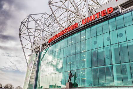 premiership: Manchester, England - February 28, 2016: The east stand of Old Trafford football stadium, home of Manchester United. With space for 75,957 spectators, Old Trafford has the second-largest capacity of any English football stadium after Wembley Stadium. Editorial