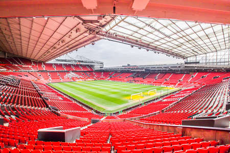 Manchester, UK - February 27, 2016: Old Trafford is a football stadium in Old Trafford, Greater Manchester, England, and the home of Manchester United. With a capacity of 75,635, it is the largest club stadium of any football team in the United Kingdom, t 新聞圖片