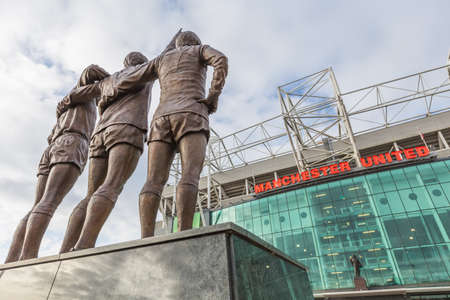 Manchester, England - February 28, 2016: To celebrate the 40th anniversary of Uniteds first European Cup title, a statue of the clubs holy trinity of George Best, Denis Law and Bobby Charlton