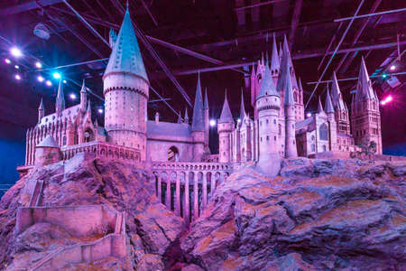 London, United Kingdom - March 3, 2016 - A scale model of Hogwarts at The Warner Bros. Studio Tour - Making of Harry Potter.The films based on the best selling series of books by the author J. K. Rowling. 版權商用圖片 - 56610565