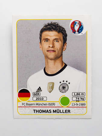 Bangkok, Thailand - June 1, 2016: Panini Official licensed sticker of Thomas Muller who is player of Germany for 2016 UEFA Euro France. 版權商用圖片 - 57541140