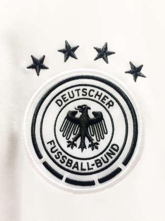 BANGKOK, THAILAND - June 9, 2016: The logo of Germany national football team on official jersey. 版權商用圖片 - 58009433