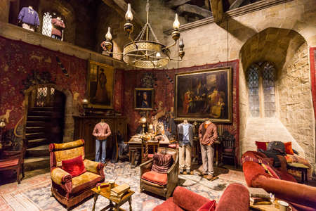 harry: Leavesden, London - March 3 2016: Gryffindor common room, with costumes worn by the cast in the Warner Brothers Studio tour The making of Harry Potter.