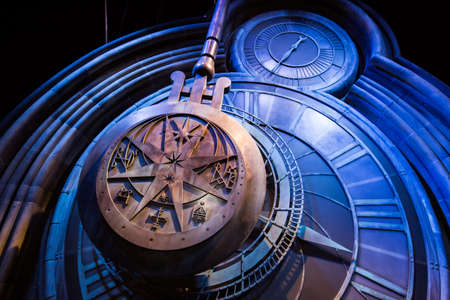 warner: Leavesden, London - March 3 2016: A giant clock in Hogwarts as featured in Harry Potter and the Prisoner of Azkaban, the Warner Brothers Studio tour The making of Harry Potter.