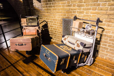 harry: Leavesden, London - March 3 2016: Trolley and luggages from Harry Potter film, the Warner Brothers Studio tour The making of Harry Potter. Editorial