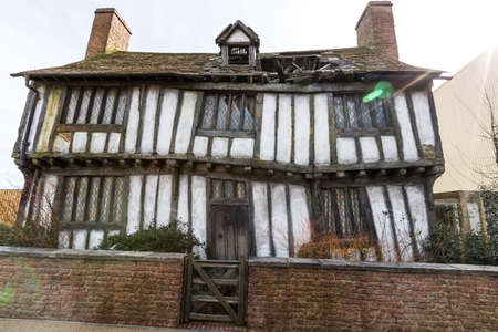 warner: Leavesden, London - March 3 2016: Potters Cottage in Godrics Hollow in the Warner Brothers Studio tour The making of Harry Potter.