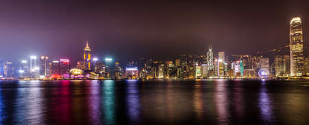 Panorama of Symphony of lights in Hongkong China from Kowloon side across from Victor Harbor 版權商用圖片 - 62609197