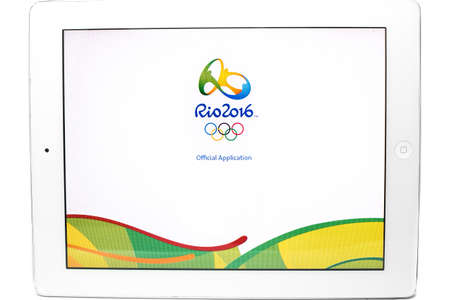 olympic symbol: Bangkok, Thailand - July 31, 2016: Official application of the 2016 Summer Olympic Games in Rio de Janeiro, Brazil, from August 5 to August 21, 2016,  on Ipad isolated on white background.