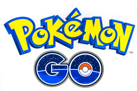 catch: Bangkok, Thailand - August 20, 2016:   Pokemon Go logo on paper. Pokemon Go is a free-to-play augmented reality mobile game developed by Niantic for iOS and Android devices.