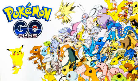 Bangkok, Thailand - August 20, 2016:   Pokemon Go logo with many pokemons on paper. Pokemon Go is a free-to-play augmented reality mobile game developed by Niantic for iOS and Android devices. 版權商用圖片 - 61496734