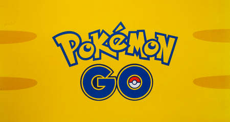 Bangkok, Thailand - August 20, 2016:   Pokemon Go logo on paper. Pokemon Go is a free-to-play augmented reality mobile game developed by Niantic for iOS and Android devices. 版權商用圖片 - 61496735