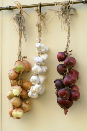 Hanging plaits of onion and garlic