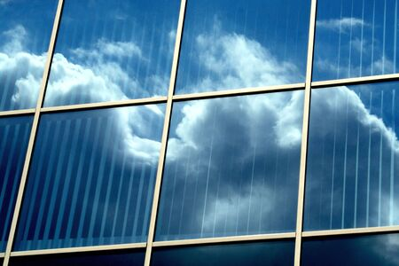Mirror building with clouds reflection