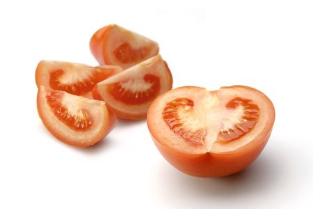 Pieces of sunny tomatoes on white Stock Photo