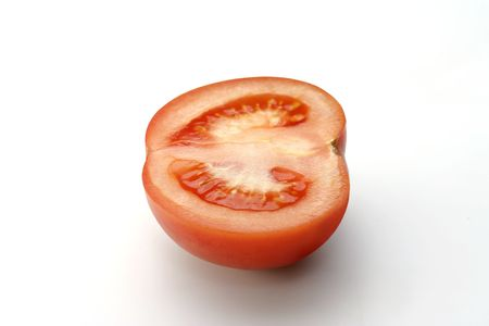 Half of sunny tomato on white