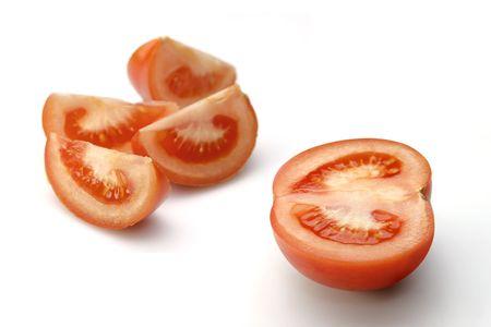 Cut sunny tomato on white Stock Photo